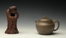 紫砂壶图片:造型新颖 耐品可人 全手青段禅钟 国助和石装饰 - 美壶网