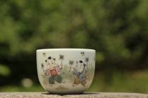 古月山房紫砂壶 双人童子风筝 景德镇主人杯  - 美壶网