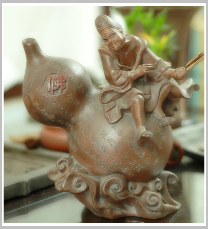人格魅力的培养_谈谈济公的手中的破蕉扇 宜兴紫砂壶- 紫砂知识 - 美壶网
